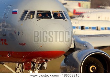 ZHUKOVSKY, MOSCOW REGION, RUSSIA - NOVEMBER 22, 2014: Aviastar-TU Tupolev TU-204C RA-64021 taxiing at Zhukovsky.