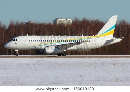 ZHUKOVSKY, MOSCOW REGION, RUSSIA - FEBRUARY 18, 2015: New Comlux Sukhoi Superjet-100 RA-89033 for VIPs at Zhukovsky.