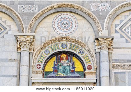 Mosaic by Giuseppe Modena da Lucca of the Saint Reparata, lunette above left door of the Cathedral (Duomo) in Pisa, Tuscany, Italy