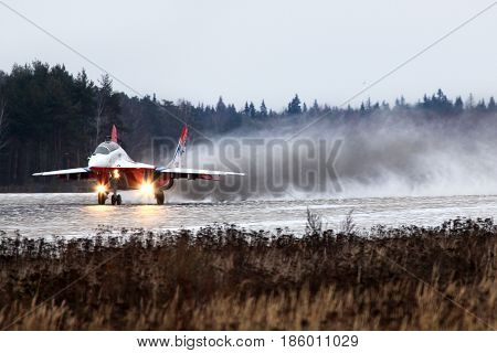 KUBINKA, MOSCOW REGION, RUSSIA - NOVEMBER 27, 2011: Mikoyan MiG-29UB 09 BLUE jet fighter taking off at Kubinka air force base.
