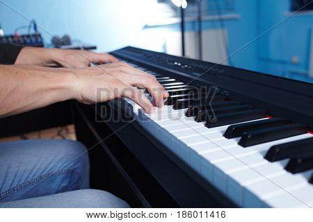 Playing the piano keyboard close up