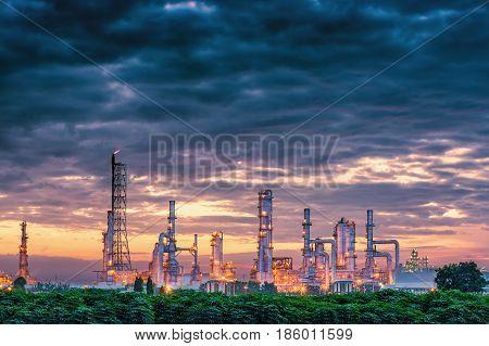 Petrochemical plant on twilight scene. Oil refinery plant.