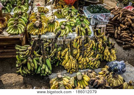 Bananas in white plastic box in traditional fruit market photo taken in Bogor Indonesia java