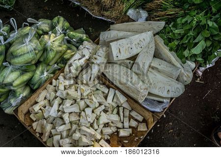 slices of young jackfruit and cucumber on sale in traditional market photo taken in Bogor Indonesia java