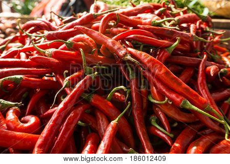 Pile of red chili on sale in traditional market photo taken in Bogor Indonesia java