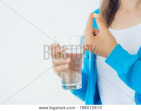 medicine health care and people concept - close up of woman taking in pill