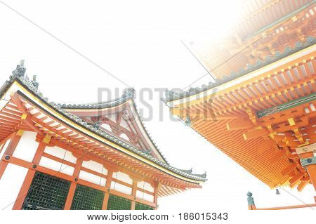 Low Angle View Of Japanese Architecture Buildings And Roof Details Of Pagoda Against White Sky At A