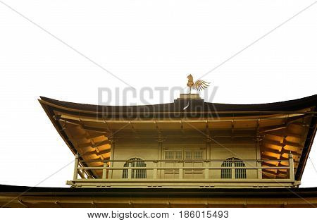 Close up detail of Kinkaku-ji or the Golden Pavilion temple with weathercock decoration on rooftop in isolated white background Kyoto Japan