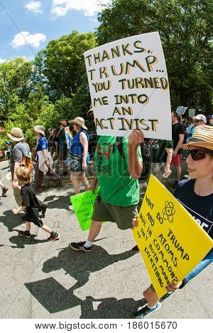 ATLANTA, GA - APRIL 22:  A man holds up a sign that says