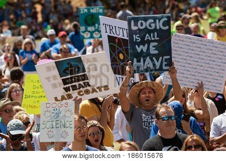 ATLANTA, GA - APRIL 22: Thousands of people crowd Candler Park and hold up signs as they take part in a rally preceding the Atlanta March for Science on Earth Day in Atlanta GA on April 22 2017.