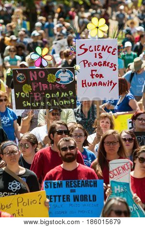 ATLANTA, GA - APRIL 22:  Thousands crowd Candler Park and hold up signs as they take part in a rally preceding the Atlanta March for Science on Earth Day in Atlanta GA on April 22 2017.