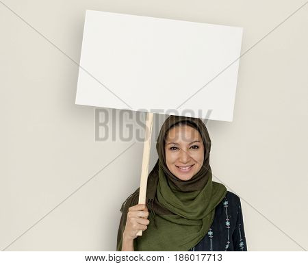 Arabian Woman Face Covered with Hijab Holding Board Sign Studio Portrait