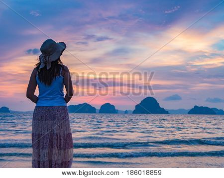 Lonely young woman on the beachsad concept.