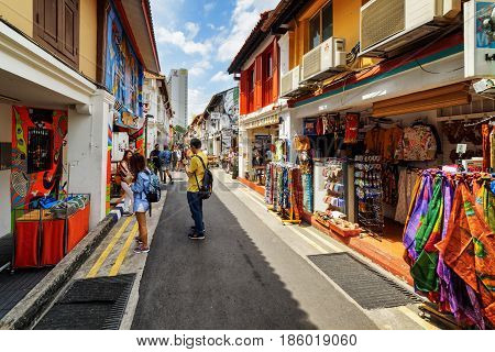 Tourists Walking Along Gift Shops At Haji Lane In Singapore