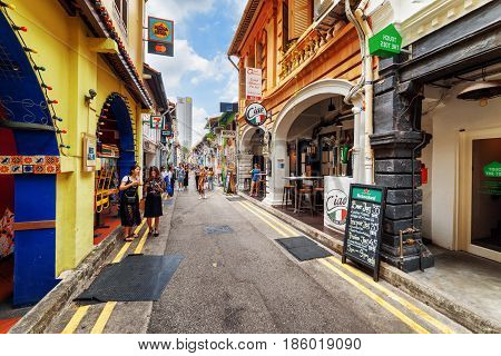Tourists Walking Along Haji Lane In Singapore