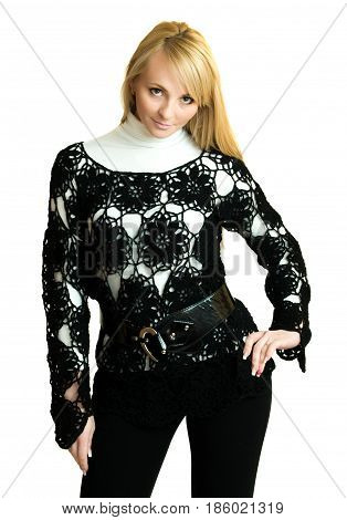 Beautiful girl in black knitted jacket over white bcakground.