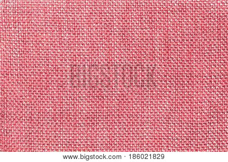 Light pink background with checkered pattern closeup. Structure of the red fabric with natural texture. Cloth backdrop.