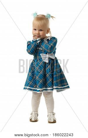 The little girl in a blue chequered dress.