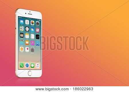 Varna, Bulgaria - March 10, 2016: Gold Apple iPhone 7 with iOS 10 on the screen on gold gradient background with copy space. Quick mockup for your design. High quality studio shot.