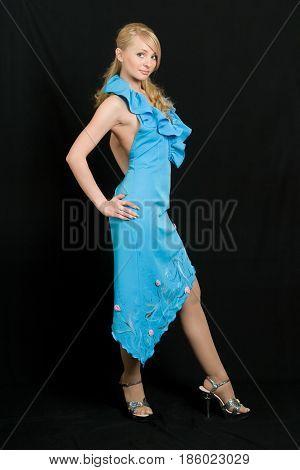 Portrait of the beautiful woman in blue dress.