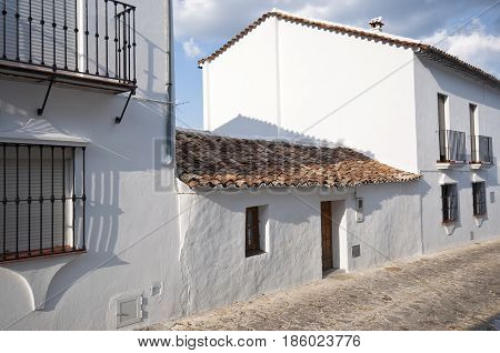 Traditional white houses in Grazalema town, Spain. This village is part of the pueblos blancos -white towns- in southern Spain, Andalusia region