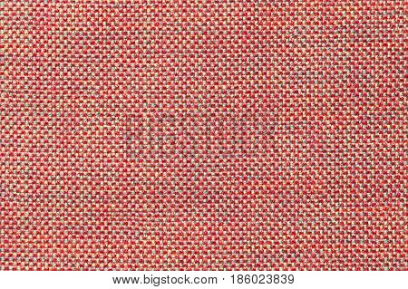 Dark pink background with checkered pattern closeup. Structure of the light red fabric with natural texture. Cloth backdrop.