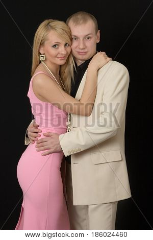 The young girl embrace the guy for a neck and he embraces her for a waist.