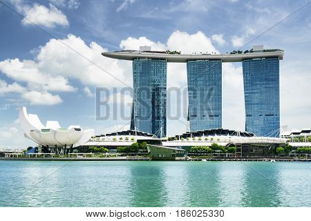 Singapore - February 16, 2017: Amazing view of Marina Bay with azure water and the Waterfront Promenade in the Central Area of Singapore. Beautiful cityscape. Singapore skyline