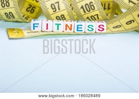 Measuring tape of yellow color and inscription by malinkish beavers fitness. blue or blue background Empty space for copy paste text
