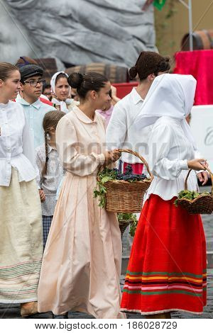 FUNCHAL MADEIRA PORTUGAL - SEPTEMBER 4 2016: Group of people in traditional costume. Madeira Wine Festival - Historical and Ethnographic parade in Funchal on Madeira. Portugal