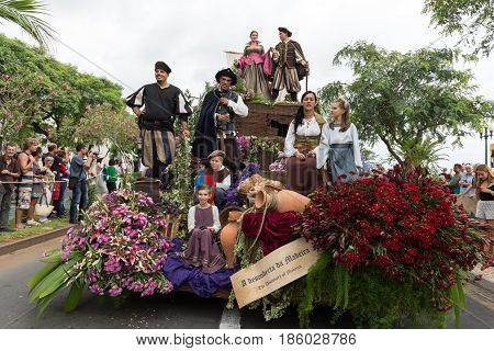 FUNCHAL PORTUGAL - SEPTEMBER 4 2016: Group of people in traditional costume durnig historical and ethnographic parade of Madeira Wine Festival in Funchal. Madeira Portugal