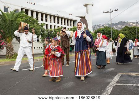 FUNCHAL PORTUGAL - SEPTEMBER 4 2016: Group of people in traditional costume durnig historical and ethnographic parade of Madeira Wine Festival in Funchal. Madeira Portugall