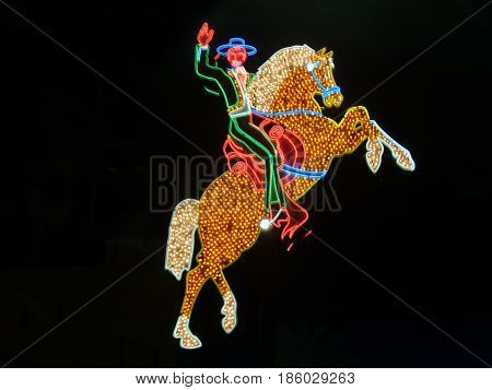 Las Vegas, USA - August 13, 2008; Old Hacienda Horse and Rider neon against black night background now in Downtown Fremont District Las Vegas.