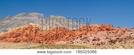 clear blue sky above red the striped rock outcrops and hilss of Red Rock Canyon Nevada USA