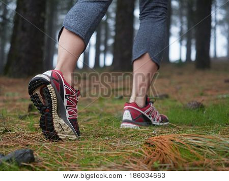 feet of young woman hiking. Concept of trip and adventure