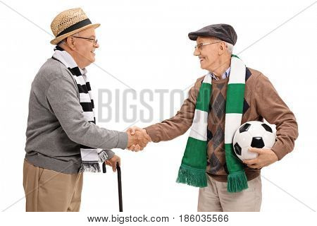Two elderly football fans shaking hands isolated on white background