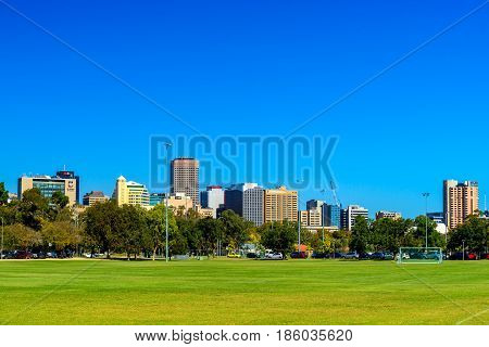 Adelaide Australia - April 14 2017: Adelaide city skyline view across northern parklands on a bright day
