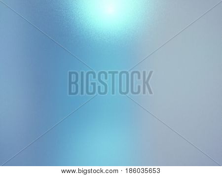 Blurred frosted glass texture background with light reflection Grey and blue colors.