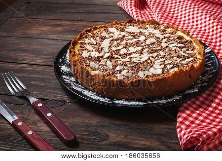 Homemade cheesecake - healthy organic summer dessert pie cheesecake. Cheese cake on wood table.