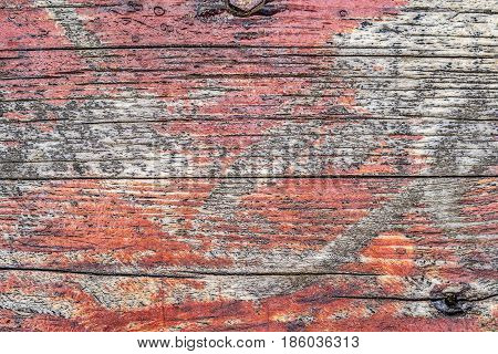 closeup of old red wooden varnished texture background with many irregularities and scratches