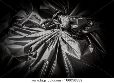 Black garbage bag as background. Close up of the node. Shallow DOF.