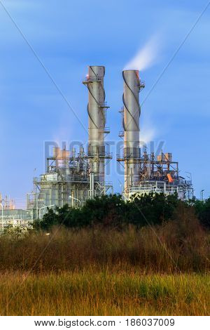 Gas turbine electrical power plant with blue sky at dusk