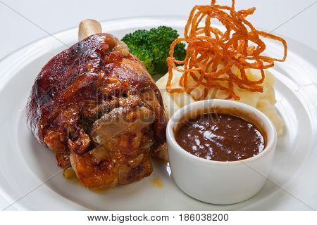 Bavarian Roasted Knuckle Of Pork And Mashed Potatoes On Bright Background