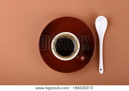 Full Small Brown Cup Of Black Coffee On Parchment