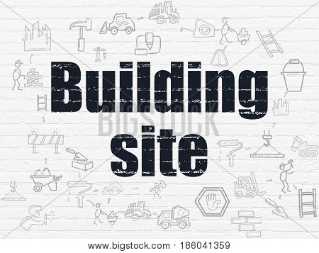 Constructing concept: Painted black text Building Site on White Brick wall background with Scheme Of Hand Drawn Construction Icons