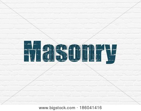 Constructing concept: Painted blue text Masonry on White Brick wall background