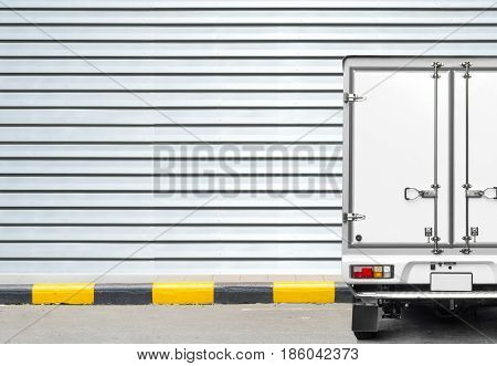 Delivery truck and transportation car concept - Delivery truck parking for delivery a parcel to receiver on footpath and copyspace
