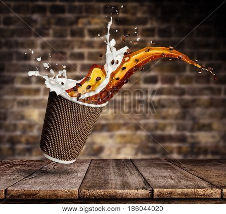 Take away cup with splashing coffee and milk liquid on wooden planks. Hot drink with splash, beverages and refreshment.
