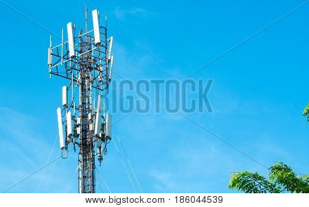 Communication cell phone and background concept - Cell phone antenna with blue sky and could with copyspace