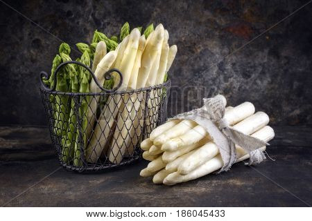 Row green and white Asparagus as close-up on an old rustic metal sheet